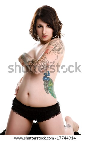 stock photo : pretty pin-up tattoo girl kneeling
