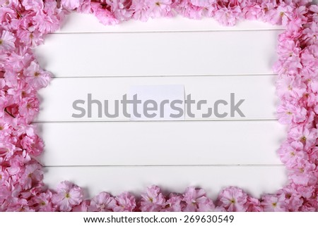 Pretty  Pink Cherry Blossoms along top and side of Painted Rustic White Board Background with room or space for copy, text, your words.