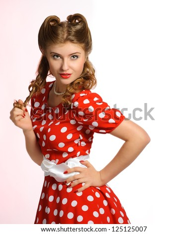 pretty pinup model in a red and white polka-dot dress
