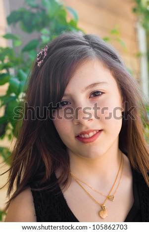Pretty portrait of teenage girl outside