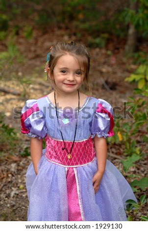 Pretty Princess - A pretty little girl dressed in her princess dress playing outdoors