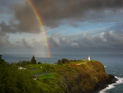 Pretty rainbow over Kilauea lighthouse at the North Shore of Kauai, Hawaii.