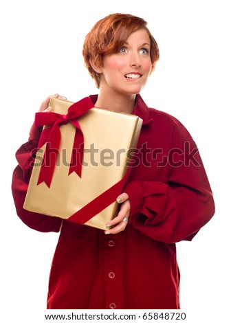 Pretty Red Haired Girl Biting Her Lip Holding Wrapped Gift Isolated on a White Background.