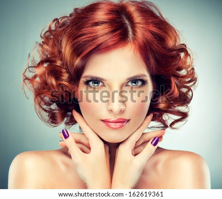 pretty red-haired girl with curls