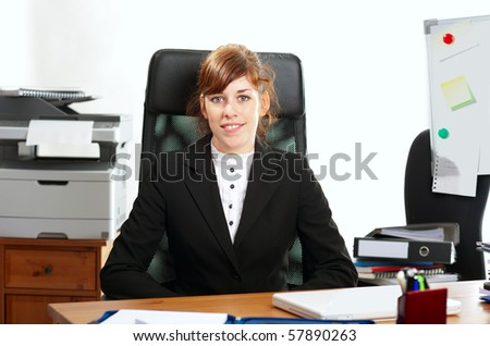 Pretty redhaired business lady or student working at a desk
