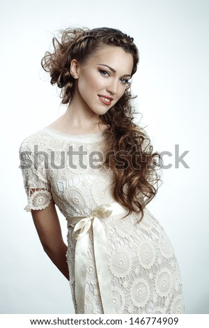 Pretty russian woman with long curly hair