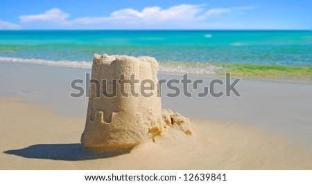 Pretty sand castle built at seashore