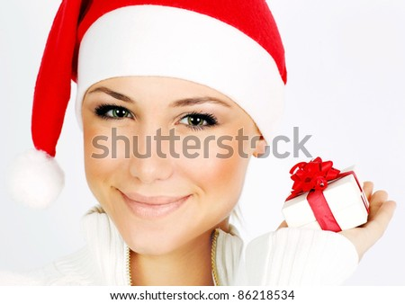 Pretty Santa girl closeup portrait, holding present gift box isolated on white background
