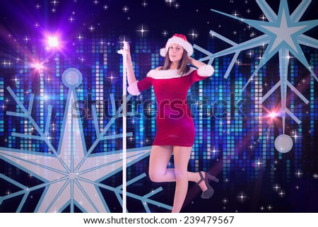 Pretty santa girl posing with hand against digitally generated cool pixel background