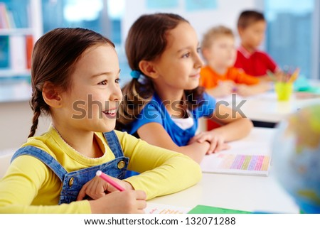 Pretty school children being attentive at the lesson