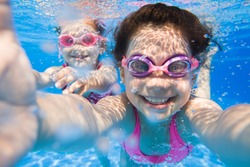 Pretty selfie  two little girls under the water.