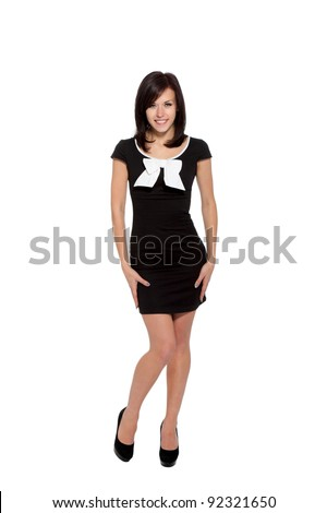Pretty sexy girl full length posing in a nice black dress isolated over white background, series photo