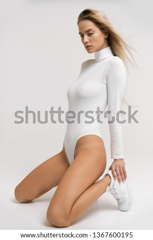 Pretty sexy girl posing in bodysuit with very fashion style, good for advertise and kind of sport goods #1367600195