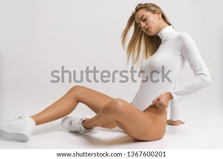 Pretty sexy girl posing in bodysuit with very fashion style, good for advertise and kind of sport goods #1367600201