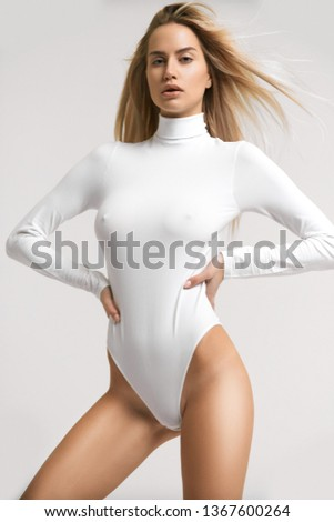 Pretty sexy girl posing in bodysuit with very fashion style, good for advertise and kind of sport goods #1367600264
