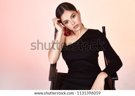 Stock Photo Pretty sexy lady fashion model glamour style beautiful woman studio background clothes black dress skinny body shape brunette hair accessory earrings make up cosmetic for face collection  date party.