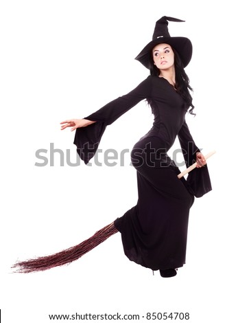 pretty sexy young brunette witch flying on a broom, isolated against white background