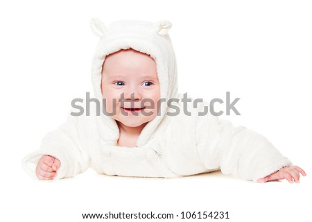pretty smiley baby lying on white floor