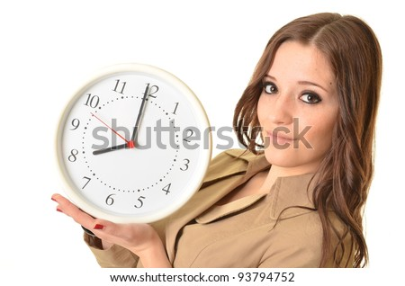 Pretty smiling brunette woman holding a clock