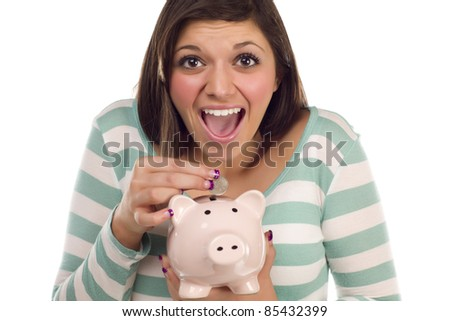 Pretty Smiling Ethnic Female Putting a Coin Into Her Pink Piggy Bank Isolated on a White Background.