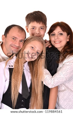 Pretty smiling family posing on a white background