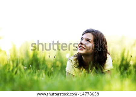 Pretty smiling girl relaxing outdoor - stock photo