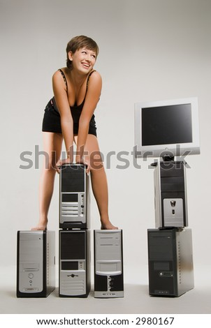 Pretty smiling girl standing on computer shassis