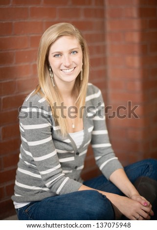Pretty smiling happy young woman portrait