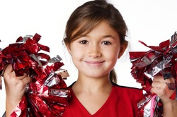Pretty smiling little girl cheerleader