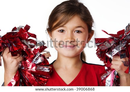 Pretty smiling little girl cheerleader
