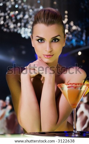 pretty smiling woman drinking cocktail in nightclub, different kinds of lighting, shallow DOF