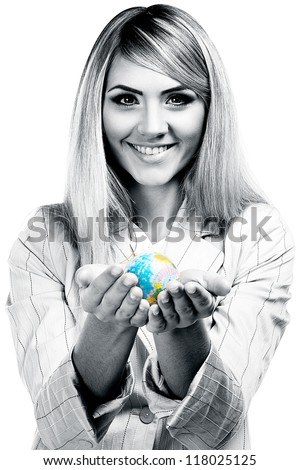 Pretty smiling woman holding a world globe and  dreaming about traveling. Business woman