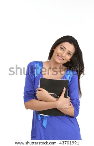 Pretty smiling woman holding books