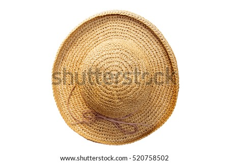 Pretty straw hat with bow on white background. Beach hat top view isolated