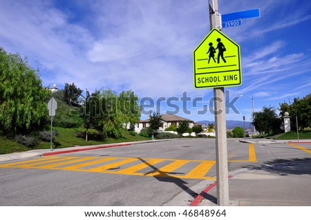 Pretty street scene of school crossing, room for your text