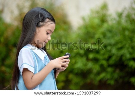 Pretty Student Child Wearing School Uniform With Phone