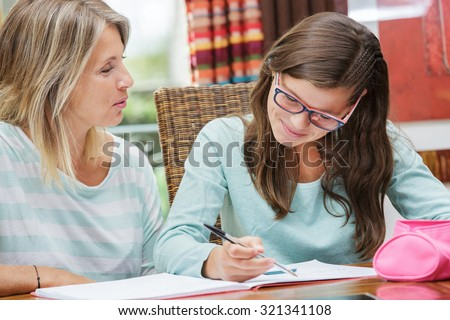 Pretty Student Girl Taking Tutoring Courses With Beautiful Blond ...