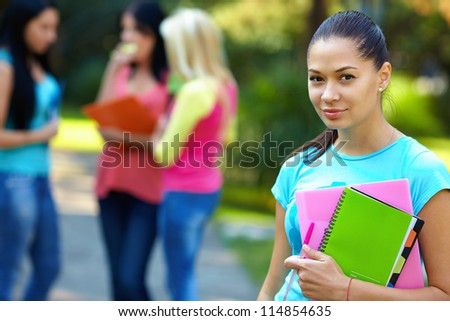 pretty student outdoors with a group of people on the background