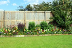 Pretty Summer Flowers And Shrubs In A Well Maintained Garden.