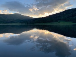 Pretty sunrise reflection of clouds over Pearl Lake near Steamboat Springs, Colorado