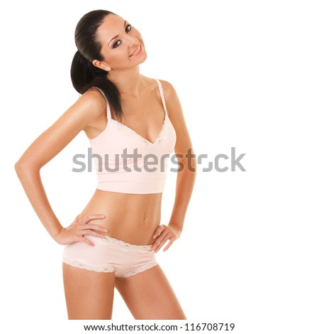 Pretty tanned woman in lingerie isolated on white background