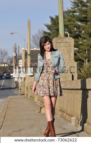 Pretty Teen Girl Walking Down The Road On A City Street Stock