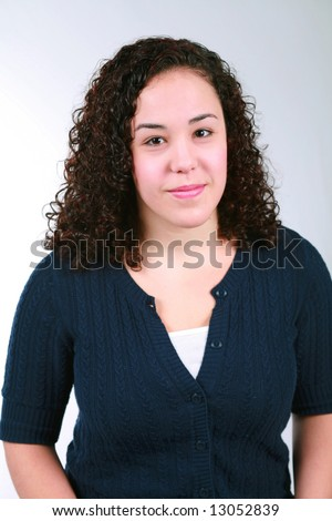 stock photo : pretty teen girl with dark curly hair smiling