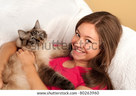 Pretty Teen Girl with Her Kitty
