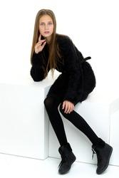 Pretty teenage girl in black stylish clothes
