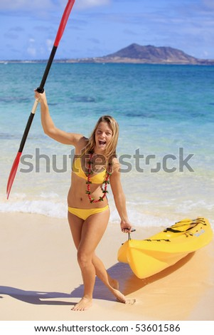 pretty teenage girl with her kayak