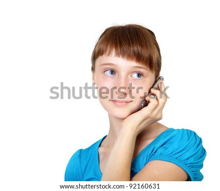 Pretty teenage girl with mobile phone in studio