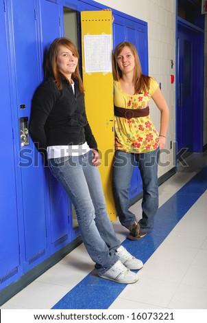 Pretty teenage students in school hallway