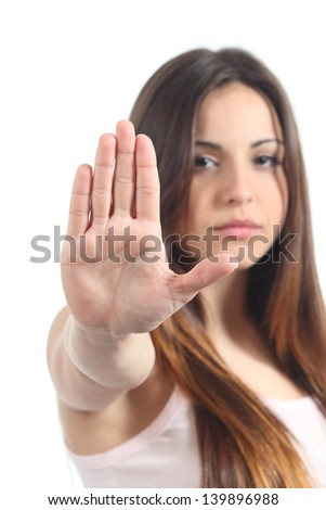 Pretty teenager girl making stop gesture with her hand isolated on a white background