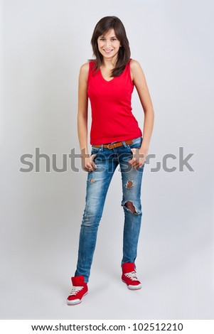 Pretty teenager girl posing at studio. - stock photo